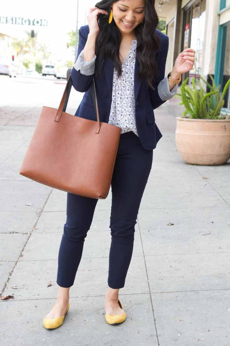 yellow earrings + brown tote + Navy ankle pants + white floral top + navy blazer + yellow flats