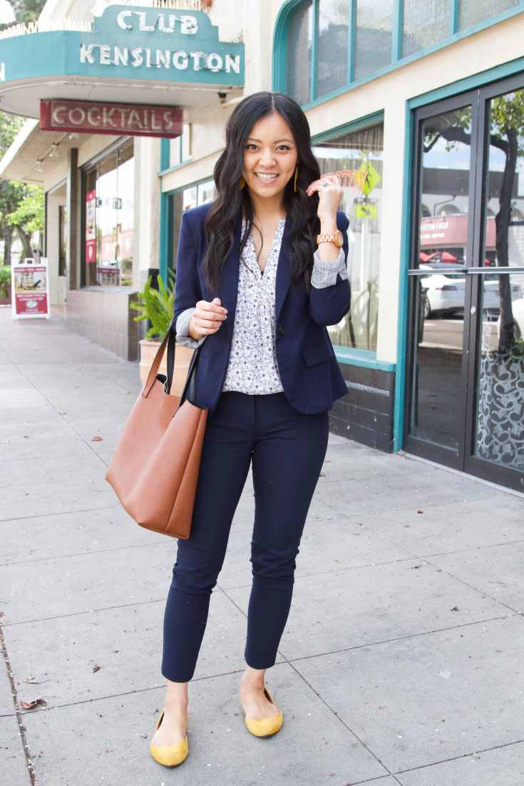 Navy ankle pants + white floral top + navy blazer + yellow flats + brown tote