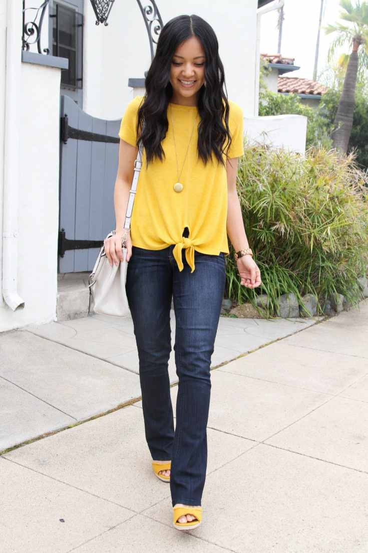 bootcut jeans + yellow tie top + yellow wedges + white bag