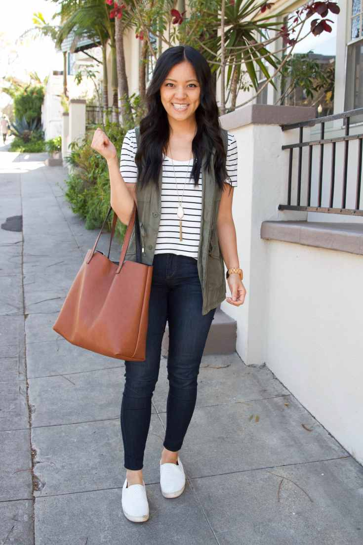 Striped Tee + Skinny Jeans + Olive utility vest + pendant necklace + brown tote + white sneakers