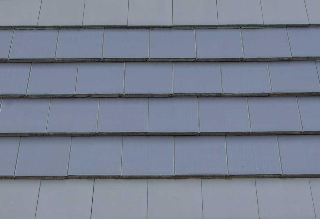 a 17 5 efficient dark grey solar tile
