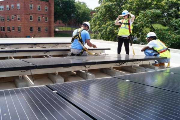 Women-installing-rooftop-solar-for-GridAlternatives