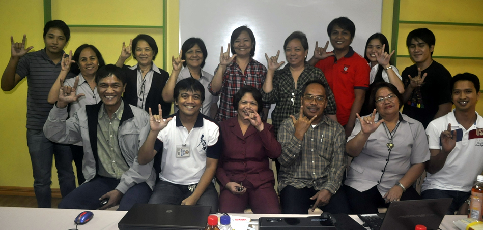 "DILG and PIA participants do the ""I Love you"" hand sign."
