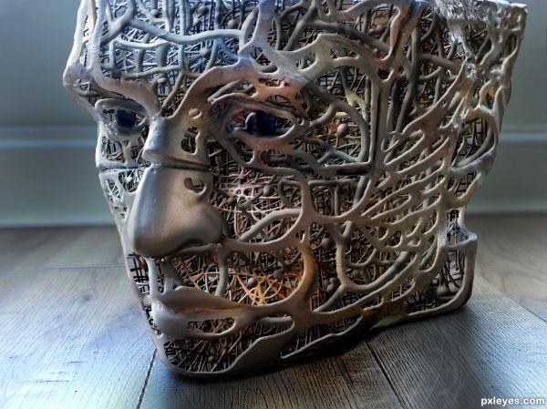 Metal Face Sculpture