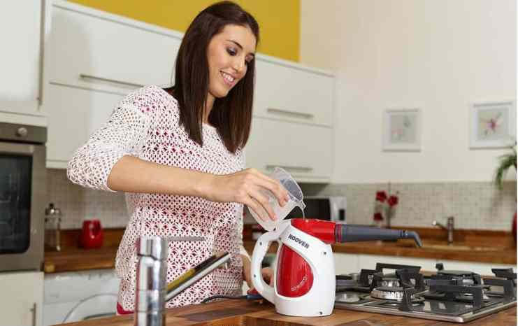 Filling Hoover Steam Express Handheld Steam Cleaner with water