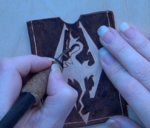 Skyrim Logo on Leather Pyrography Artwork wood burning