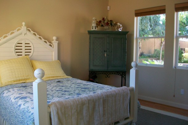 The casita bedroom has a queen bed, flat screen TV and view of the courtyard