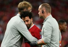Injured Mohamed Salah and Jurgen Klopp