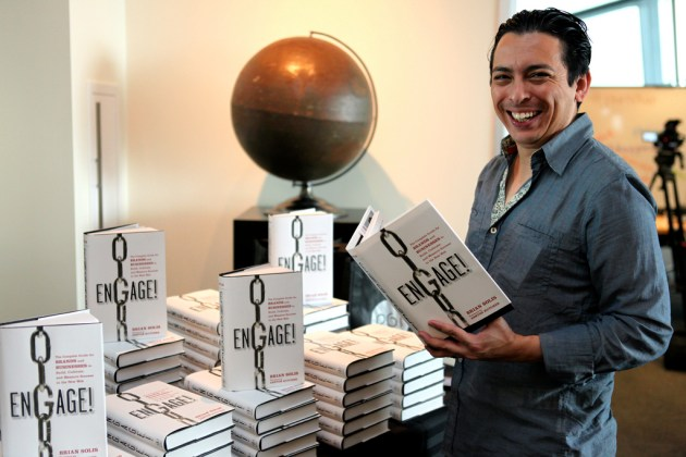 """Brian Solis holding his book, """"Engage!"""""""