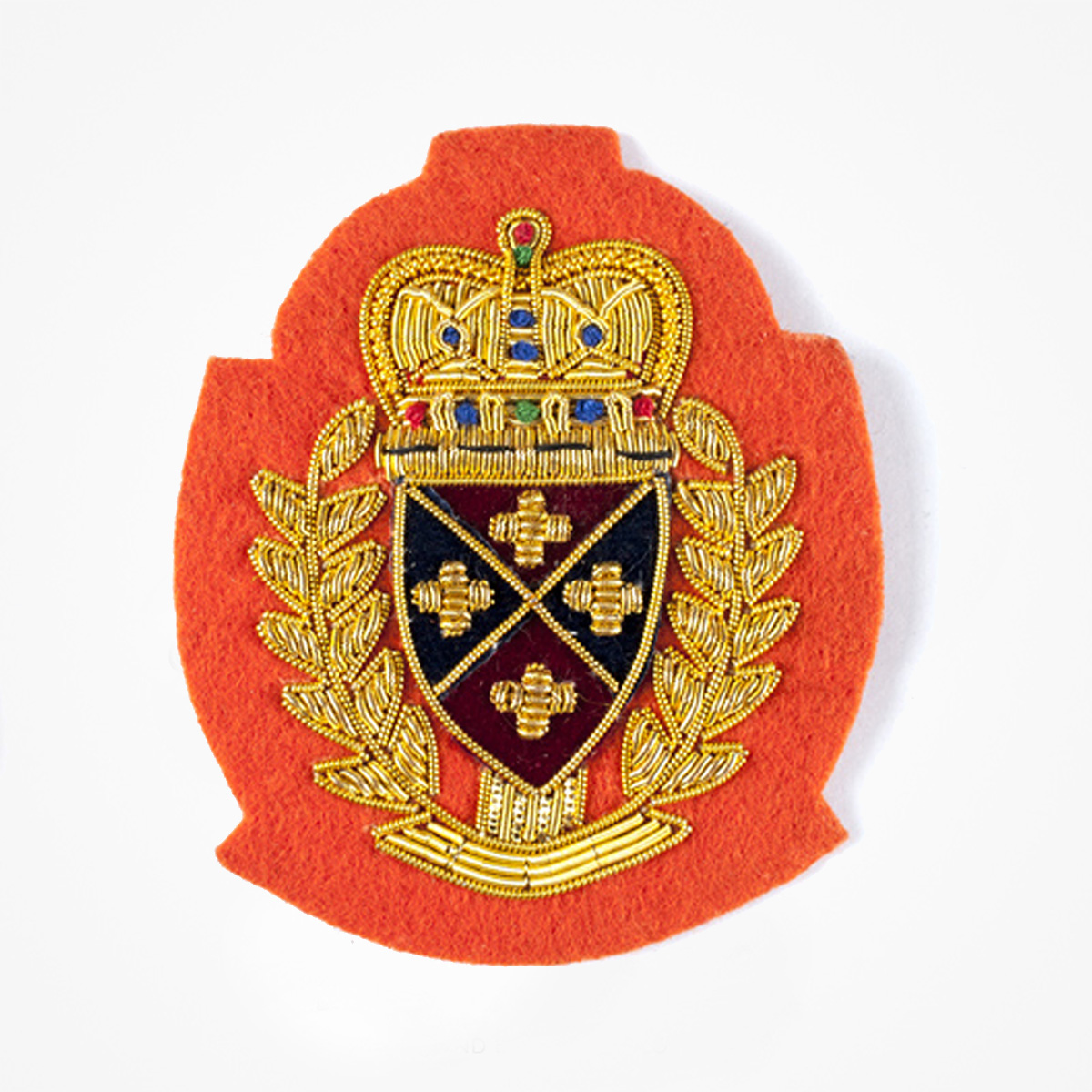 QG Gold Bullion wire Blazer Pocket Crest Patch on orange felt - Fashionable 3D embroidered look Made by skilled artisans Bullion wire and silk thread hand Stitched on Black color Felt Available in gold and silver colors Size = 72 mm height 60 mm width sewon backing: Perfect for caps, sports jacket, leather jackets, blazer coat, Blazer Pocket, shirts uniforms, Accessories and many More Pin backing: easy to removable 5