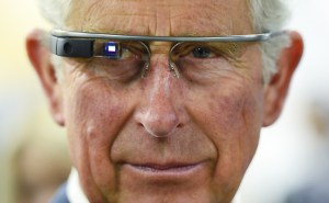 Prince Charles tries on Google Glass in Winnipeg, Manitoba, on Wednesday, May 21, 2014. The Prince of Wales was in Winnipeg as part a four-day trip to Canada with his wife, Camilla. (AP Photo/The Canadian Press, Paul Chiasson)
