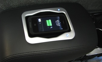 Toyota's Avalon armrest as it charges a phone.