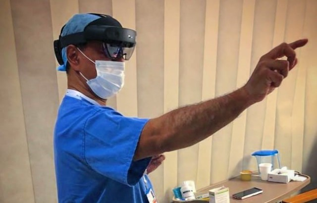Professor Shafi Ahmed using smart glasses on his ward visits