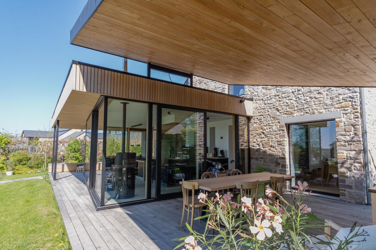Photographie pour un bureau d'architecture qui représente une extension en bois