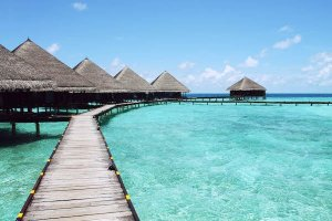 tropical paradise thatched huts on the water