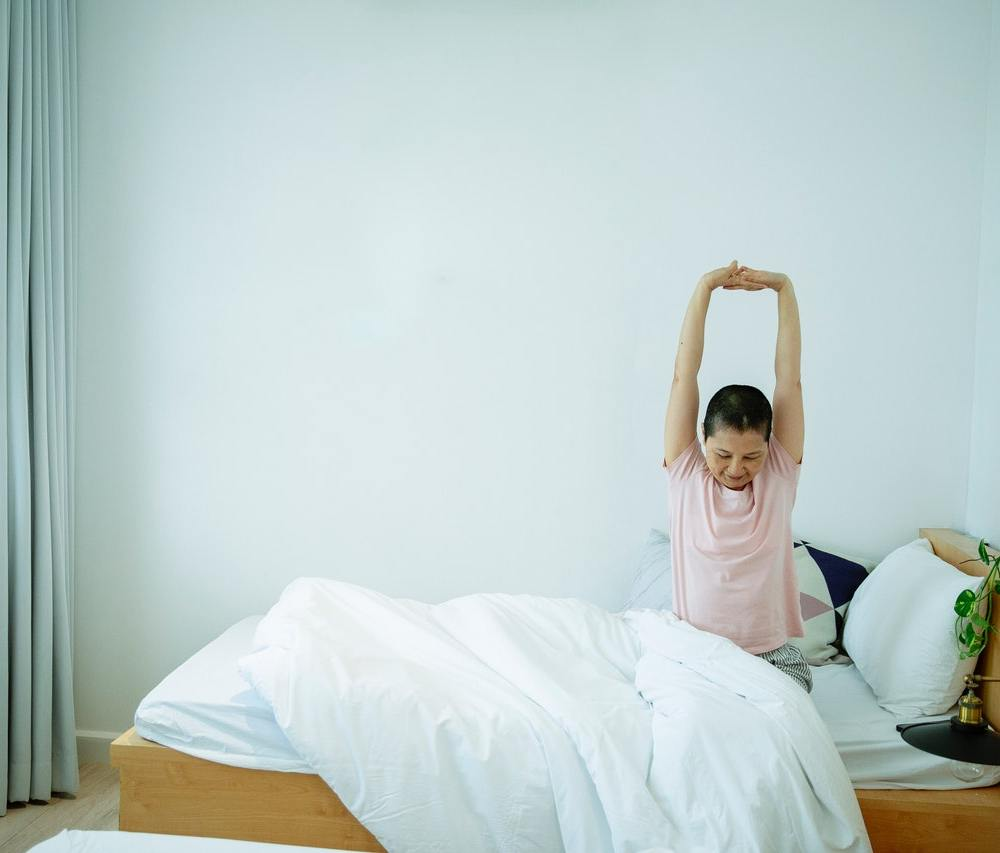 Person sleeping well and waking up refreshed
