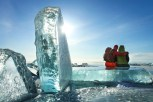 Traveler among ice of lake Baikal