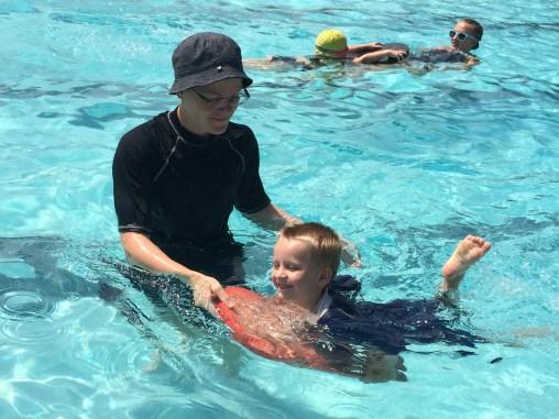 Gregory learning the kickboard on the Elmer Swim Team.