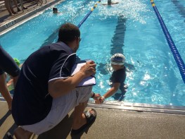Francis would sometimes leave early for relays so Elmer Swim Team Coach T. stood with him to help him understand when to go.