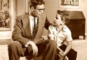 Generic 1960s pic of a father and son scene.