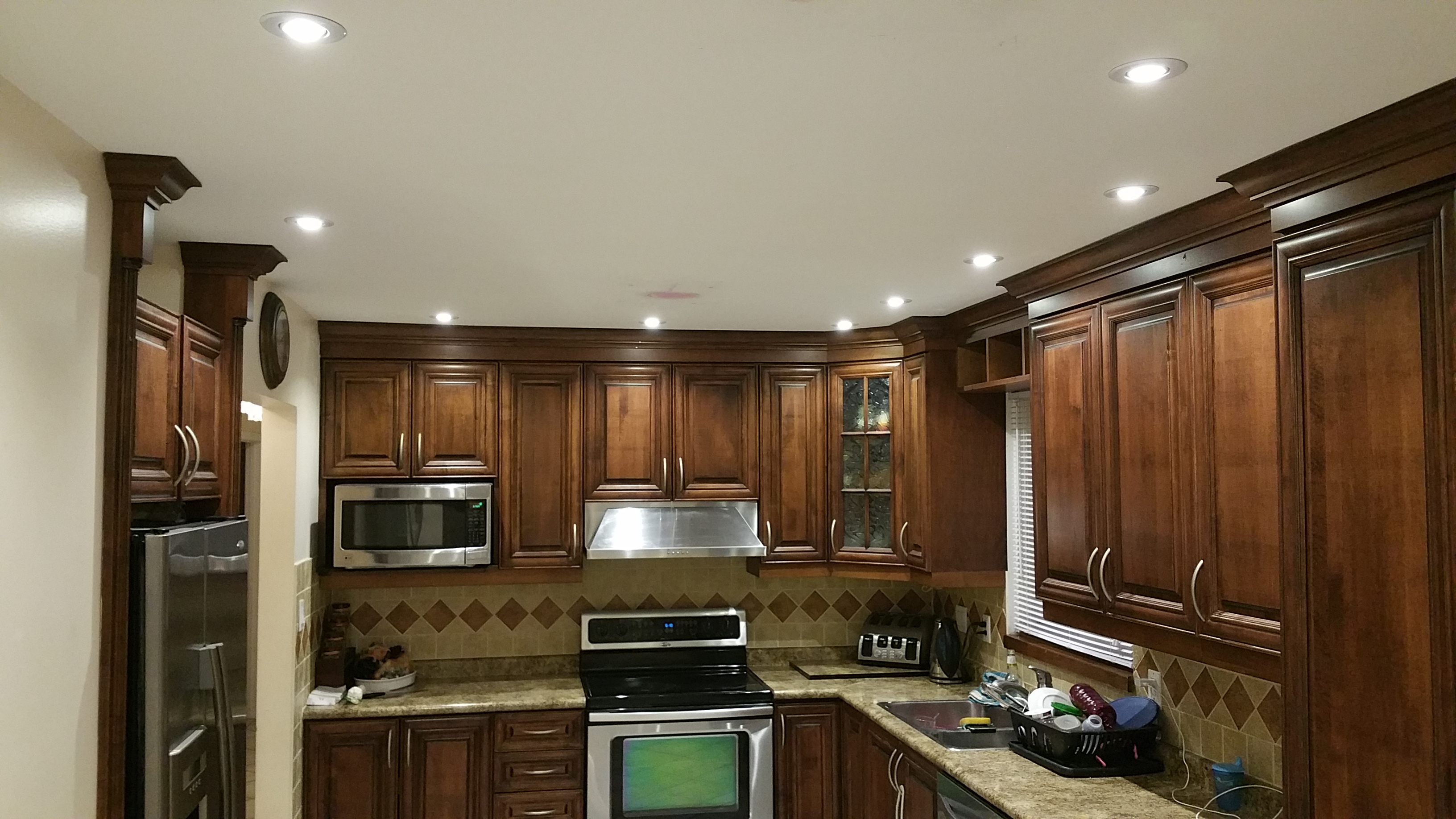 pot lights for kitchen gray floor top five renovations that increase property value quality potlight