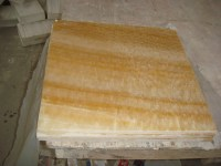 Honey onyx tile for bathroom flooring
