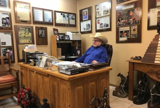 Tim McQuay sitting at his desk