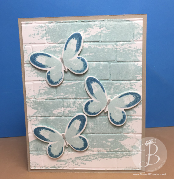Stampin' Up! Watercolor Wings stamp set on Watercolor Wash background with Bricks embossing folder and center pop up