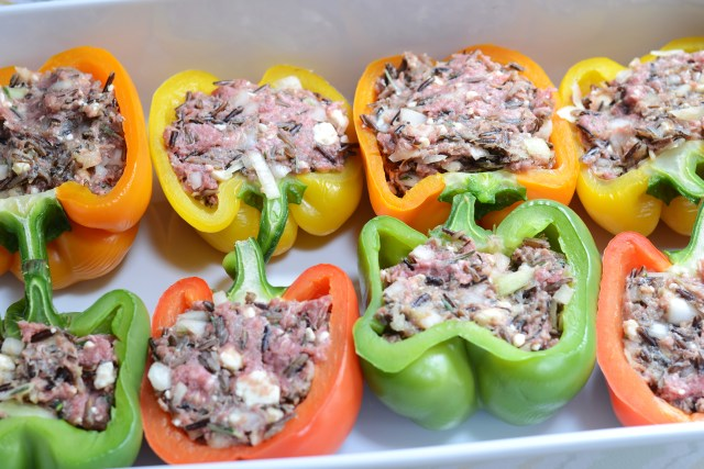 Blue Cheese, Rosemary, and Wild Rice Stuffed Peppers are gluten-free and only 262 calories per serving. A great make ahead dish for casual entertaining. | QueenofMyKitchen.com