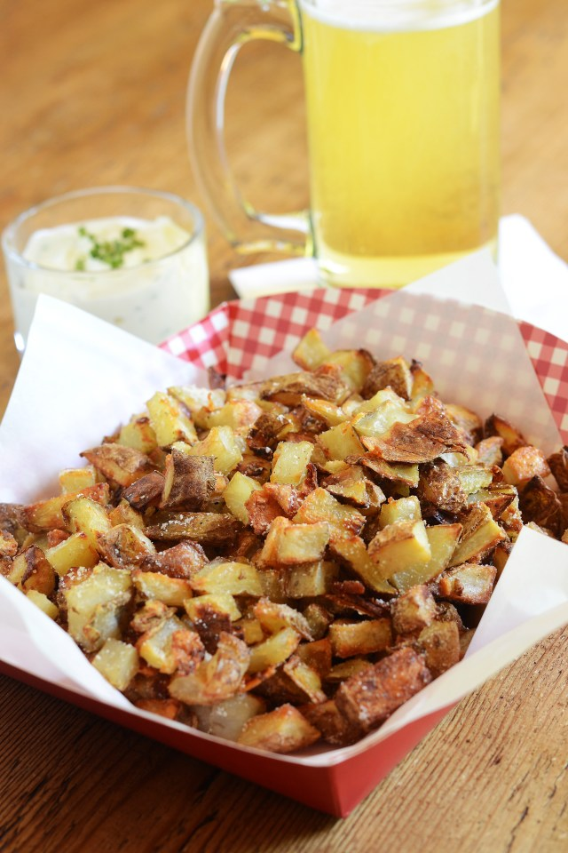 Oven roasted in olive oil, Crispy Parmesan Potato Bits are a little bit of french fry heaven without the toxins imparted by deep fat frying in factory refined oil. | QueenofMyKitchen.com