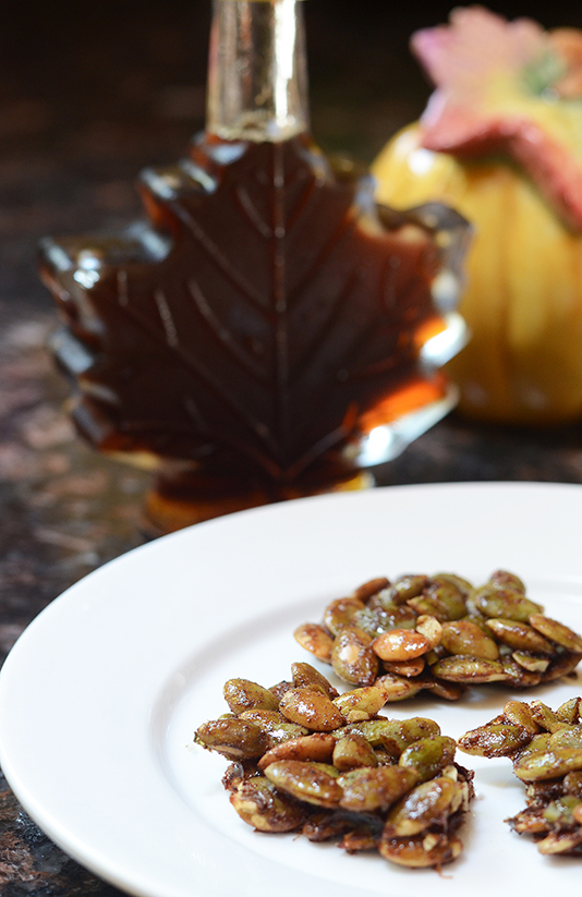 Maple Glazed Pumpkin Seed Clusters - raw pumpkin seeds roasted in coconut oil, coated with fall scented spices, and glazed with pure maple syrup. | QueenofMyKitchen.com