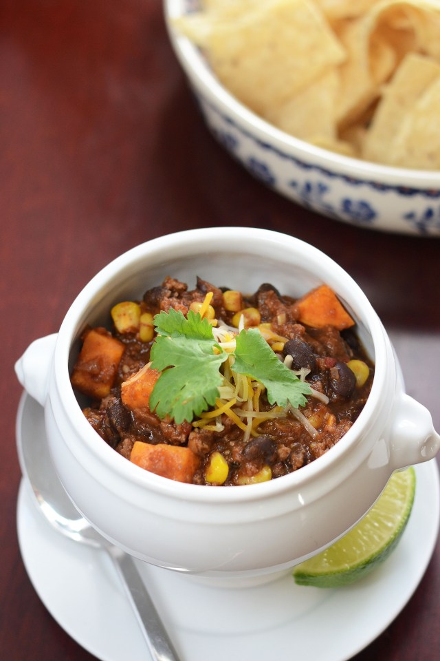 Turkey, Sweet Potato, and Black Bean Chili with Chipotle and Chorizo.  Sweet, spicy, smoky and utterly delicious – the perfect game day chili. | QueenofMyKitchen.com