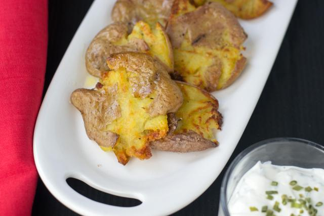 Crispy Smashed Baby Potatoes with Bacon Bits and Chive Sour Cream-easy enough for weeknight meals but elegant enough for guests.The crispiest potatoes ever!   QueenofMyKitchen.com