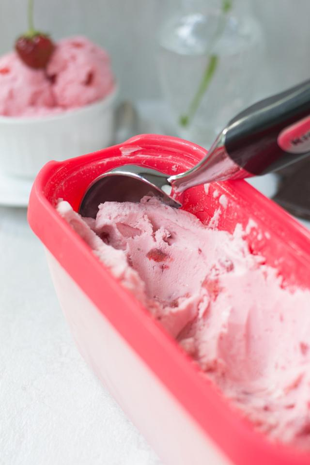 Maple Sweetened Strawberry Ice Cream - delicious and subtly sweet with bright, tangy flavor. Sweetened with maple syrup instead of refined white sugar. Gluten-free. | QueenofMyKitchen.com