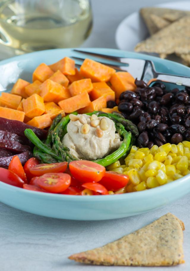 Rainbow Veggie Hummus Bowl - chock-full of colorful, nutrient dense vegetables and delicious plant protein. Served with gluten-free Almond Flax Pita Bread that's a cinch to make! | QueenofMyKitchen.com