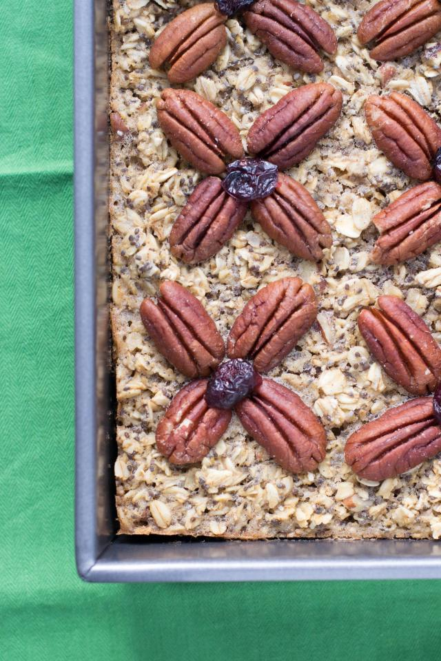 A delicious breakfast cake made from whole grains, nuts, and seeds with no flour whatsoever! Gluten-free with an egg free option. | QueenofMyKitchen.com