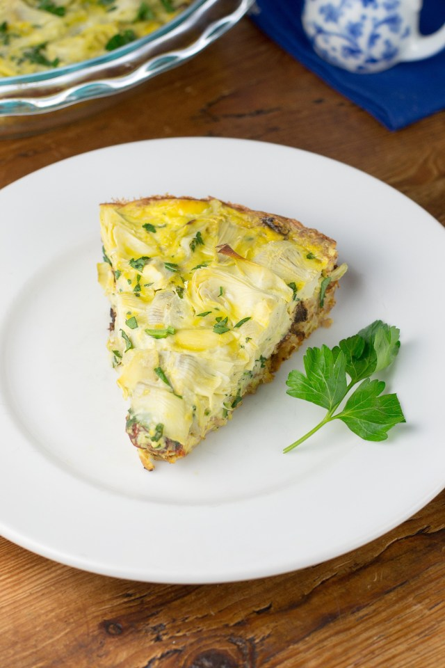 Chicken Artichoke Farro Frittata - A unique and delicious dish full of lots of savory flavors with a beautiful, floral-like top layer of artichoke hearts. | QueenofMyKitchen.com
