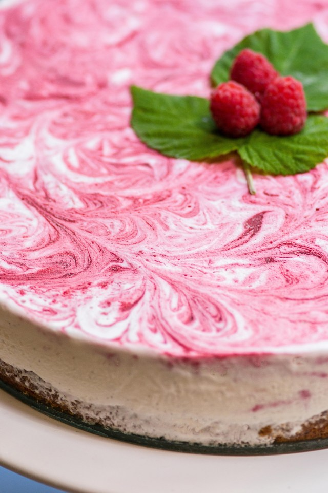 Raspberry Vanilla Swirl Ice Cream Pie with Maple Almond Cookie Crust – Raspberry purée is swirled into sweet, creamy vanilla ice cream on top of a delicious gluten-free cookie crust. An impressive, semi-homemade dessert. | QueenofMyKitchen.com