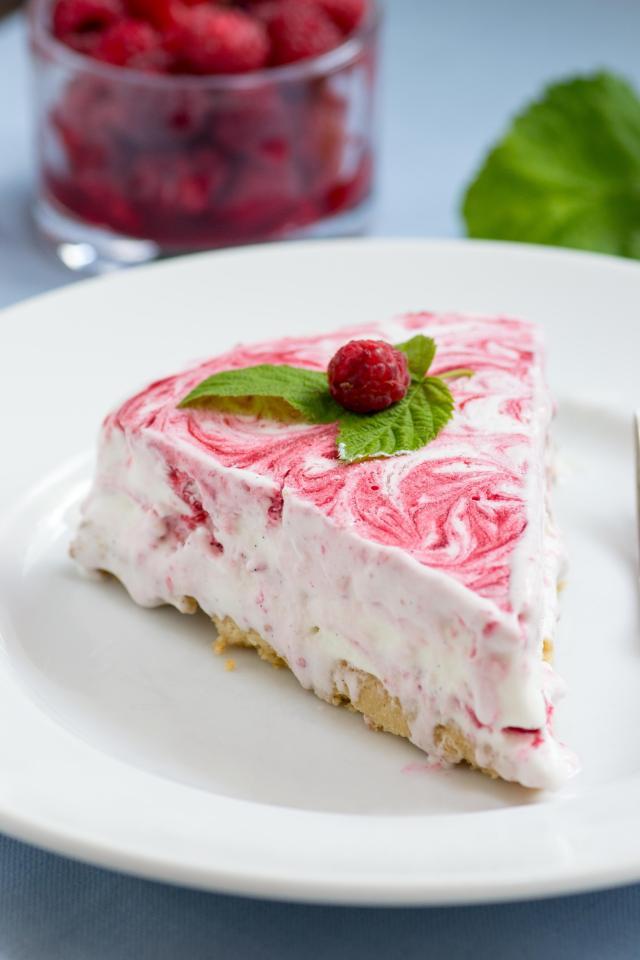 Raspberry Vanilla Swirl Ice Cream Pie with Maple Almond Cookie Crust – Raspberry purée is swirled into sweet, creamy vanilla ice cream on top of a delicious gluten-free cookie crust. An impressive, semi-homemade dessert.   QueenofMyKitchen.com