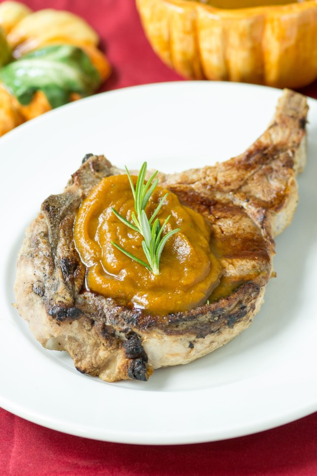 Grilled Pork Chops with Rosemary Pumpkin Butter – Pork loin chops are brined, grilled, and topped with a delicious sauce infused with classic fall flavors. No more boring pork! | QueenofMyKitchen.com