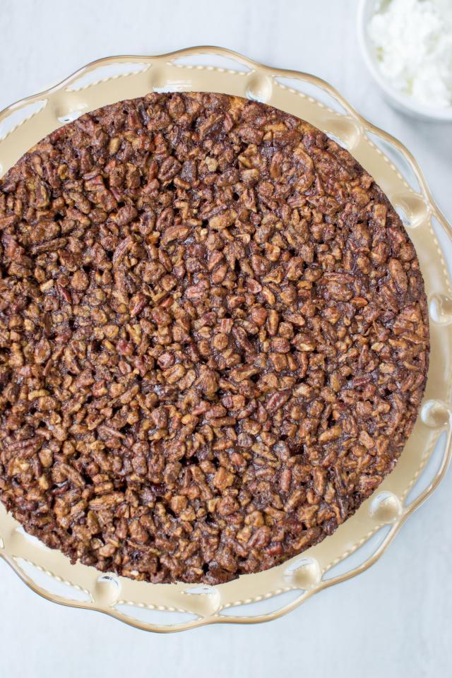 Vegan Pecan Blondie Pie - Lightly spiced candied pecans, on top of a sweet, tender blondie base, make this delicious mock pecan pie. Gluten-free, dairy-free, no refined sugar. | QueenofMyKitchen.com #pecanpie #pecanpierecipe #Thanksgiving #vegan #dairyfree #glutenfree #norefinedsugar