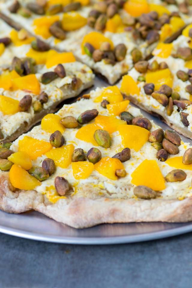 Pistachio Pizza with Peaches and Goat Cheese - Pistachios are the star of this pizza and are complemented by creamy, tangy goat cheese and soft, sweet peaches. A unique and delicious pizza. #AD | QueenofMyKitchen.com #pizza #pizzarecipe #pistachio #pistachios
