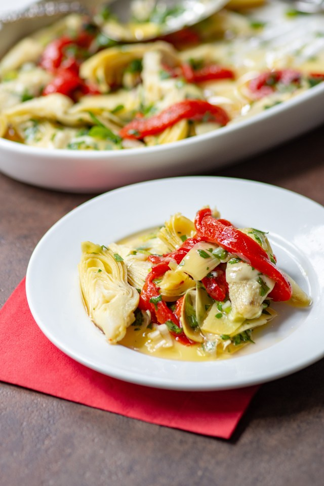 Artichoke and Roasted Red Pepper Salad - A no-cook, quick and easy antipasto salad you can make in under 10 minutes. Great for picnics, tailgates, and casual entertaining. | QueenofMyKitchen.com |#salad #antipasto #artichokes #nocook #easyrecipe #roastedredpeppers #antipastosalad #quickrecipe #picnicfood #artichokesalad #vegan #glutenfree #dairyfree