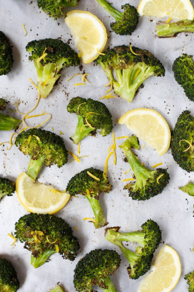 Lemony Pesto Roasted Broccoli - Basil pesto and freshly squeezed lemon juice give this bland vegetable a delicious boost of flavor. Broccoli may never be boring again! | QueenofMyKitchen.com | #vegetable #vegetables #sidedish #sides #pesto #veggies #broccoli #roastedbroccoli
