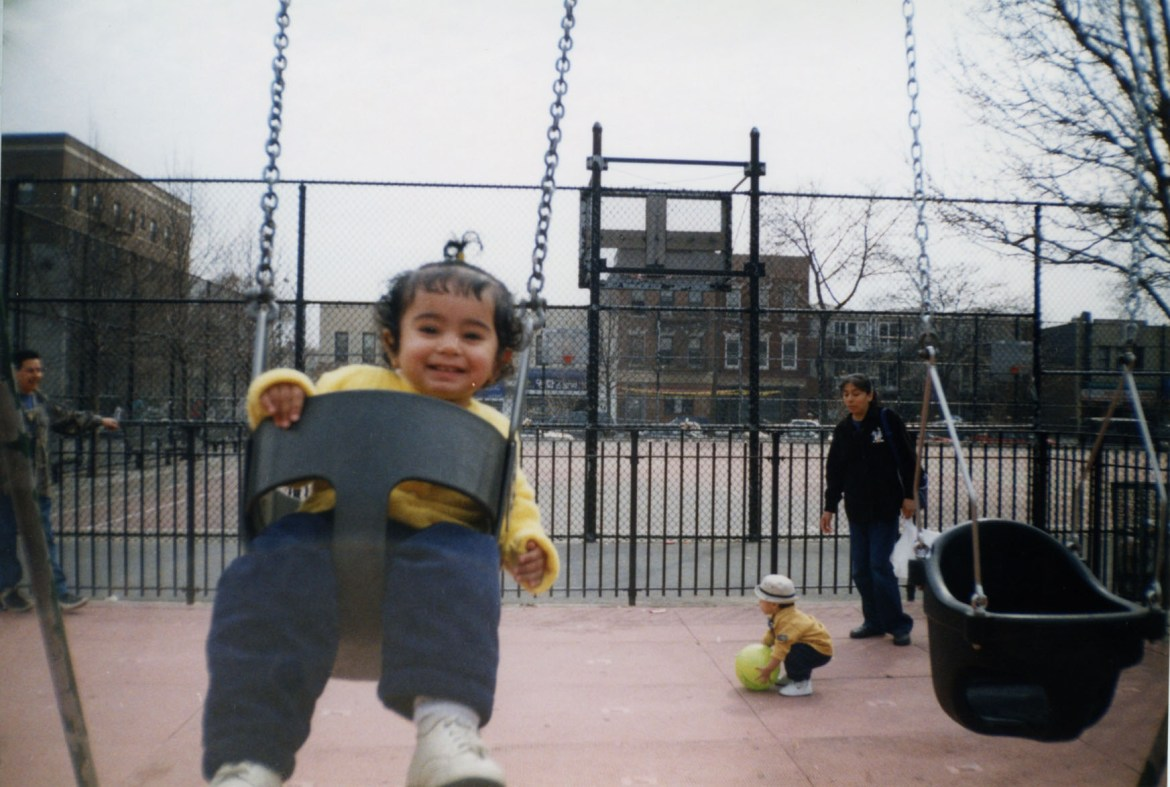 Erika Banga on the swing set at the Frank D. O'Connor Playground in Elmhurst (2003).
