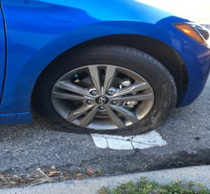 A brand new car is no match for the Van Wyck potholes.