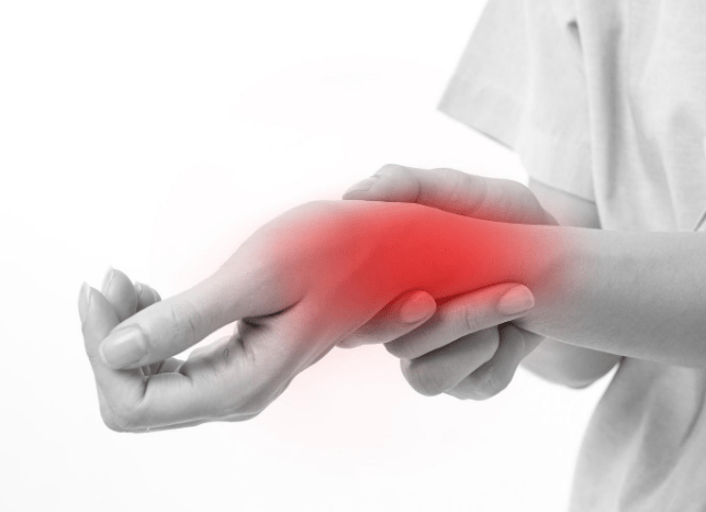 An image showing someone suffering with wrist pain
