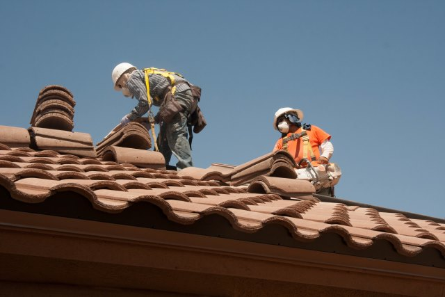 men fixing roof