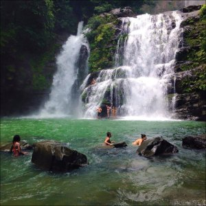 Group bathing in a waterfall