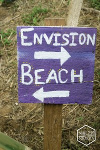 Envision/Beach sign